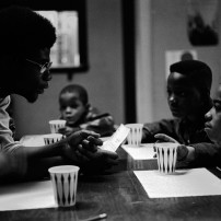 Black Panthers Combine Community Programs with Political Education and Organization